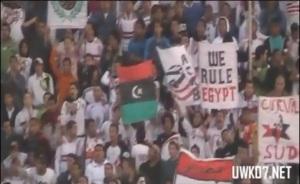 "Zamalek's fans wave banners ""We rule Egypt"" and ""Libya's people flag"""